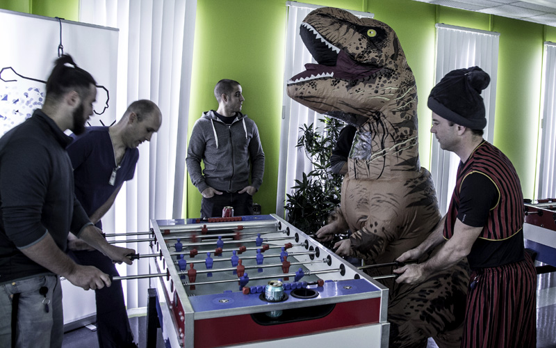 Creaform's employees playing baby foot with a T-Rex